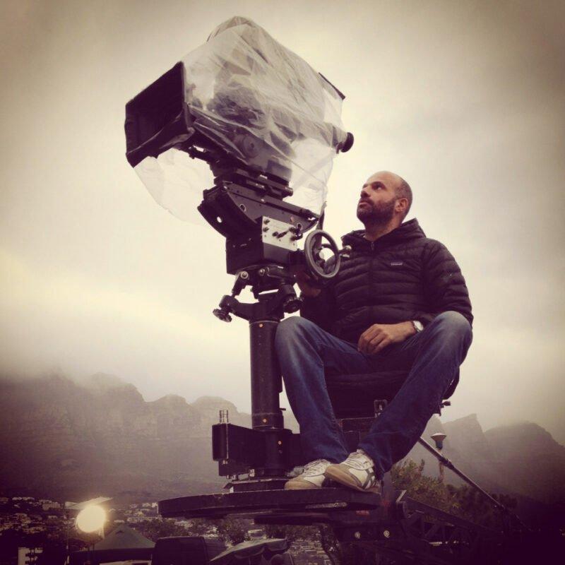 ali ali in director's chair on filmset